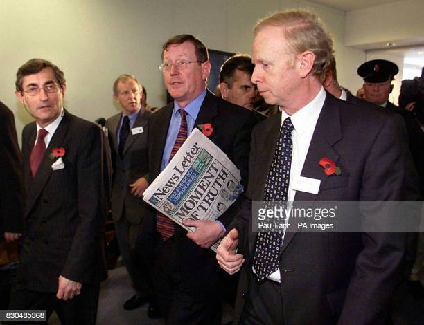 Ulster Unionist leader David Trimble with Sir Reg Empey and party Chairman Lord Rogan leaving a press conference in Belfast Waterfront Hall after...