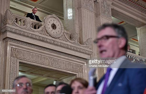 Ulster Unionist leader Mike Nesbitt is watched by a Stormont official as he holds a press conference regarding the RHI crisis at Stormont on December...