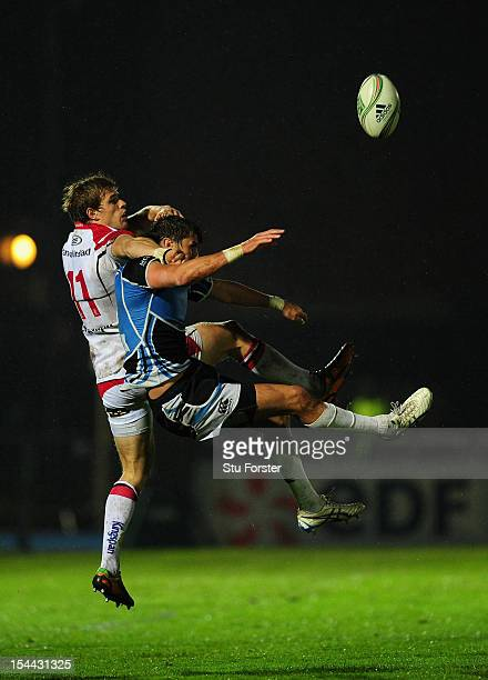 Ulster wing Andrew Trimble battles for the ball with Glasgow centre Peter Murchie during the Heineken Cup round 2 match between Glasgow Warriors and...