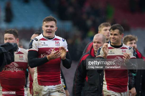 Ulsters Jacob Stockdale and team mate Louis Ludik celebrate their sides victory at full time during the European Rugby Champions Cup match between...