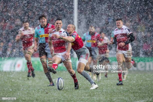 Ulsters John Cooney is tackled by Mike Brown of Harlequins during the European Rugby Champions Cup match between Harlequins and Ulster Rugby at...