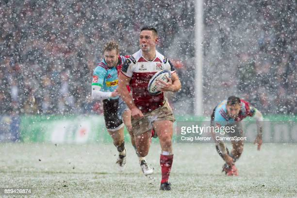 Ulsters John Cooney makes a break to set up his sides first try during the European Rugby Champions Cup match between Harlequins and Ulster Rugby at...