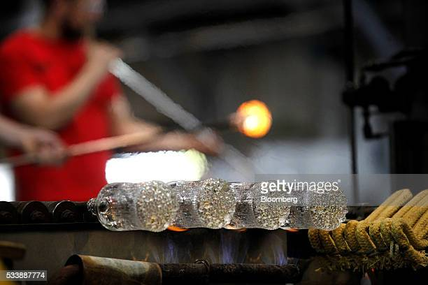 Ultima thule style glasses sit in the workshop during manufacture using traditional glass blowing methods at the Iittala Oyj glass factory operated...