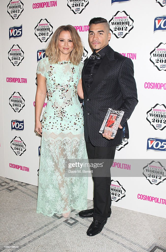Ultimate Hottie <a gi-track='captionPersonalityLinkClicked' href=/galleries/search?phrase=Louis+Smith+-+Gymnast&family=editorial&specificpeople=798756 ng-click='$event.stopPropagation()'>Louis Smith</a> (R) and presenter <a gi-track='captionPersonalityLinkClicked' href=/galleries/search?phrase=Kimberley+Walsh&family=editorial&specificpeople=202674 ng-click='$event.stopPropagation()'>Kimberley Walsh</a> pose in the press room at the Cosmopolitan Ultimate Woman of the Year awards at the Victoria & Albert Museum on October 30, 2012 in London, England.