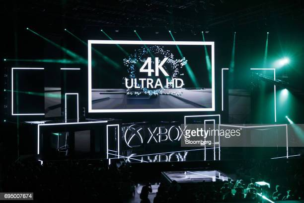 Ultra HD 4K signage is displayed on a screen during the Microsoft Corp Xbox One X reveal event ahead of the E3 Electronic Entertainment Expo in Los...