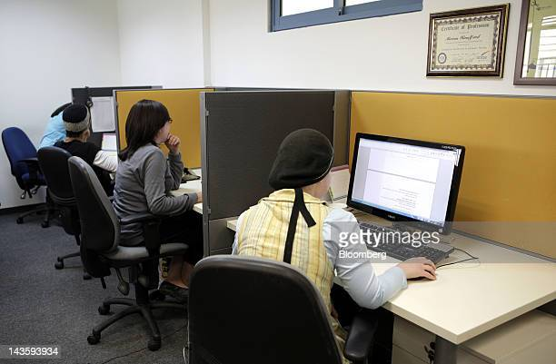 Ultra orthodox Israeli women work at computer terminals in the offices of Matrix Global a unit of Matrix IT Ltd in Modi'in Illit Israel on Sunday...