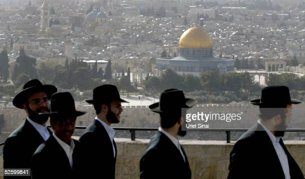 Ultra orthodox Israelis view the golden Dome of the Rock Islamic shrine on April 7 2005 in Jerusalem's Old City Israel Israel's Shin Bet security...