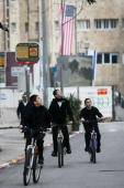 Ultra orthodox Jewish children ride their bicycle out side the King David hotel where The President of the United States George W Bush is staying...