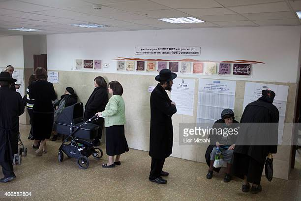 Ultra Orthodox Jewish citizens wait to cats their votes at a polling station on election day on March 17 2015 in Jerusalem Israel Israel's general...