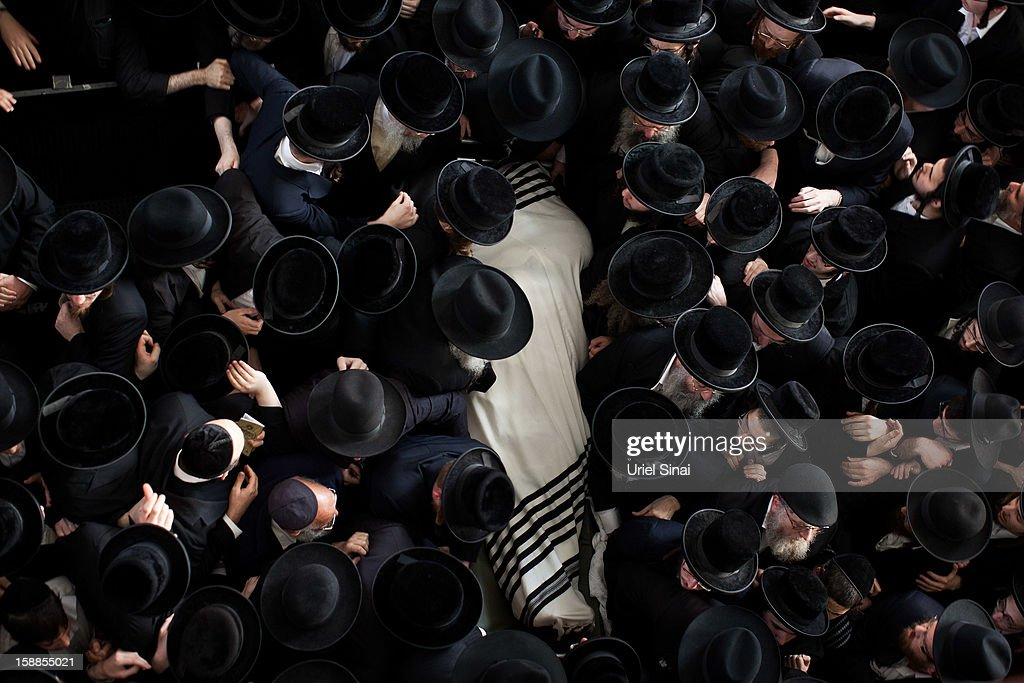 Ultra Orthodox Jewish men carry the body of Rabbi Abraham Jacob Friedman of Sadigura Hasidic dynasty during his funeral on January 01, 2013. in Bnei Brak, Israel. The Rabbi was the leader of the Sadigura Hasidic dynasty in Bnei Brak and died at the age of 84.