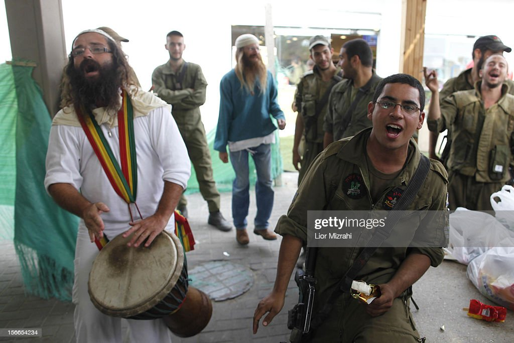 Ultra Orthodox Jewish men sing and dance for Israeli soldiers on their way to the Gaza border on November 18, 2012 in Yad Mordehai, Israel. Israeli/Gaza attacks have entered the fifth day, with two media buildings being recently struck and several journalists subsequently injured. According to health officials in Gaza, at least 50 Palestinians have been killed since Israel launched operation Pillar of Defence. So far three Israelis have died in the exchange of missiles which followed an air strike on Wednesday that killed Hamas military chief Ahmed Jabari.