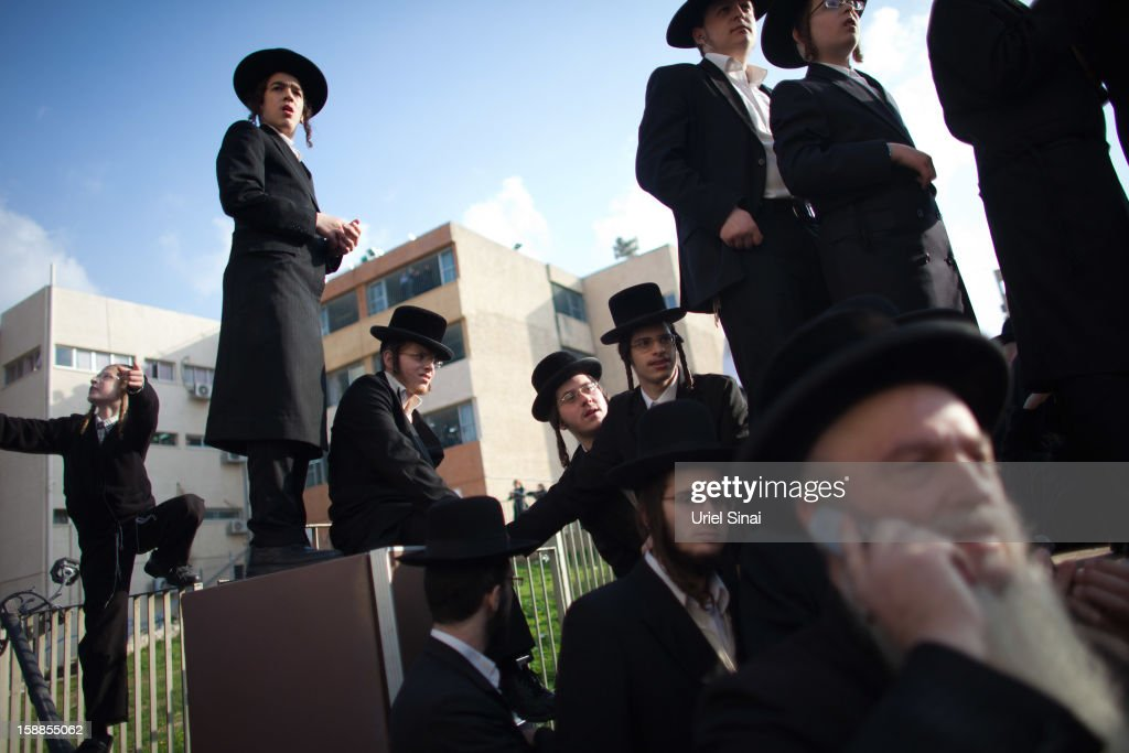 Ultra Orthodox Jewish youth look on at the funeral of Rabbi Abraham Jacob Friedman of Sadigura Hasidic dynasty on January 01, 2013. in Bnei Brak, Israel. The Rabbi was the leader of the Sadigura Hasidic dynasty in Bnei Brak and died at the age of 84.