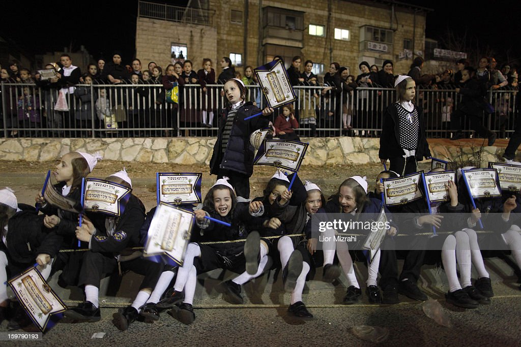 Ultra Orthodox Jewisj children belonging to the Satmar Hasidic group headed by Satmar Rebbe of Williamsburg, Rabbi Zalman Leib Teitelbaum, gather in the conservative Mea Shearim neighbourhood on January 20, 2013 in Jerusalem, Israel. The Israeli general election will be held on January 22.