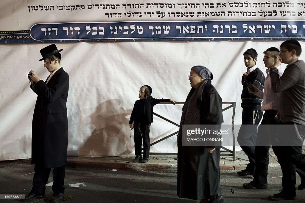 Ultra Orthodox Jews belonging to the Satmar Hasidic group headed by Satmar Rebbe of Williamsburg, Rabbi Zalman Leib Teitelbaum, gather during an anti-election rally in the conservative Mea Shearim neighbourhood of Jerusalem on January 20, 2013, two days before nationwide voting for the general election gets underway on January 22. AFP PHOTO/MARCO LONGARI