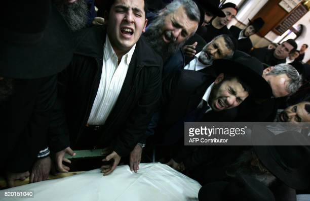 Ultra Orthodox Jews pray and grieve over the body of Rabbi Yitzhak Kaduri before his funeral 29 January 2006 in the Nahalat Yitzhak synagogue in...
