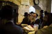 Ultra Orthodox read and pray by the 'Tomb of King David' just before the rally started outside the site on May 12 2014 in Jerusalem Israel Israeli...