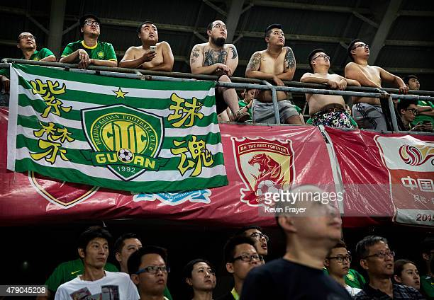 Ultra supporters and fans of the Beijing Guoan FC celebrate watch their team play gainst Chongcing Lifan FC during their Chinese Super League match...