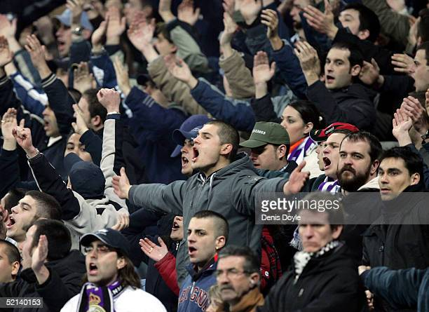 Ultra Sur fans of Real Madrid cheer during a Primera Liga soccer match against Espanyol at the Bernabeu on February 5 2005 in Madrid Spain