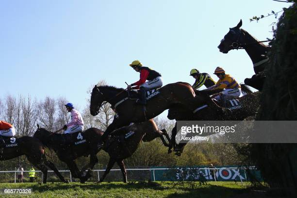 Ultragold ridden by Harry Cobden clears Bechers Brook during their victory in the Randox Health Topham Handicap Steeple Chase at Aintree Racecourse...