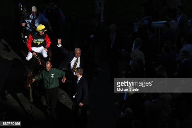 Ultragold ridden by Harry Cobden is led into the winers enclosure following victory during the Randox Health Topham Handicap Chase on Ladies Day at...