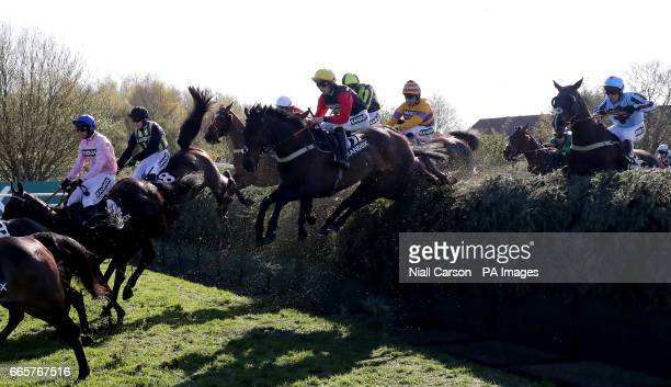 Ultragold ridden by jockey Harry Cobden jumps Becher's Brook on the way to winning the Randox Health Topham Handicap Chase on Ladies Day of the...