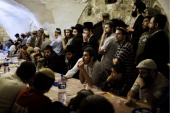 Ultranationalist orthodox Jews listen to their spiritual leader as he delivers a lecture in the King David tomb compound in mount Zion outside the...