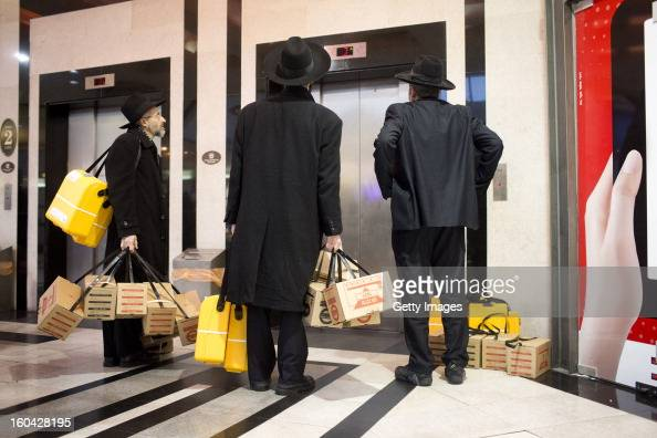 UltraOrthodox Israelis wait for an elevator after they collected gas mask kits from a distribution station in a mall January 31 in Pisgat Ze'ev East...
