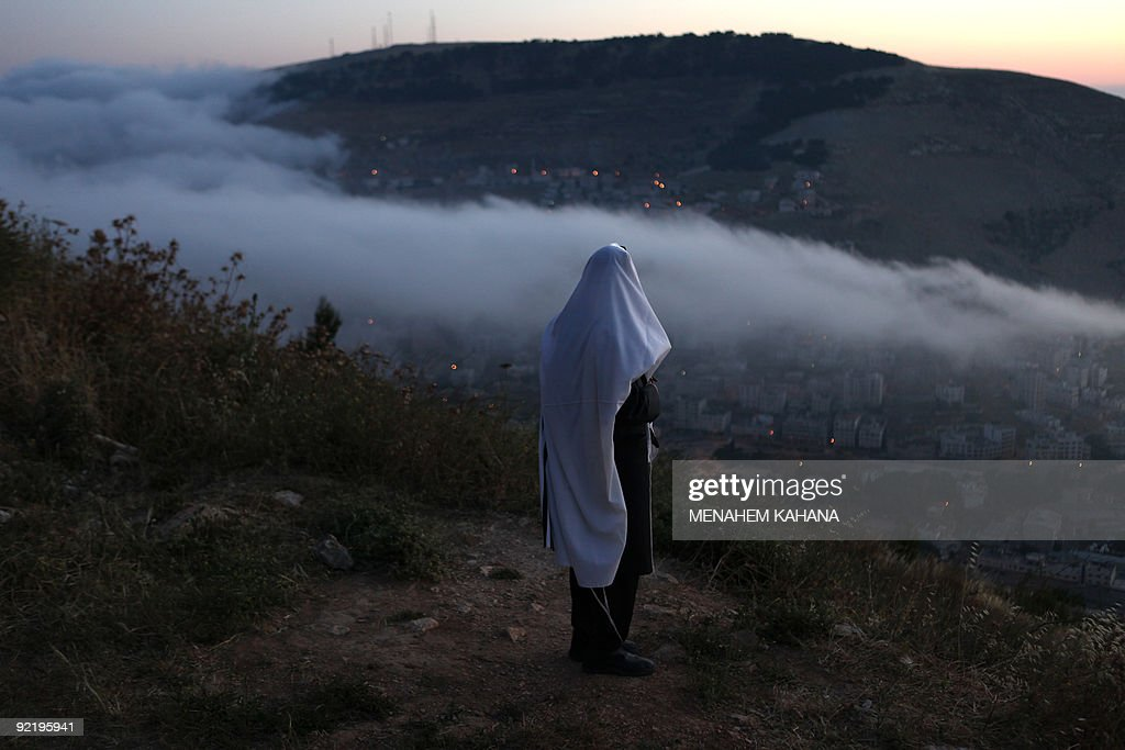 A ultraOrthodox Jew prays on Mount Gerizim overlooking Joseph's Tomb one of Judaism's holiest sites in the West Bank city of Nablus on May 28 2009...
