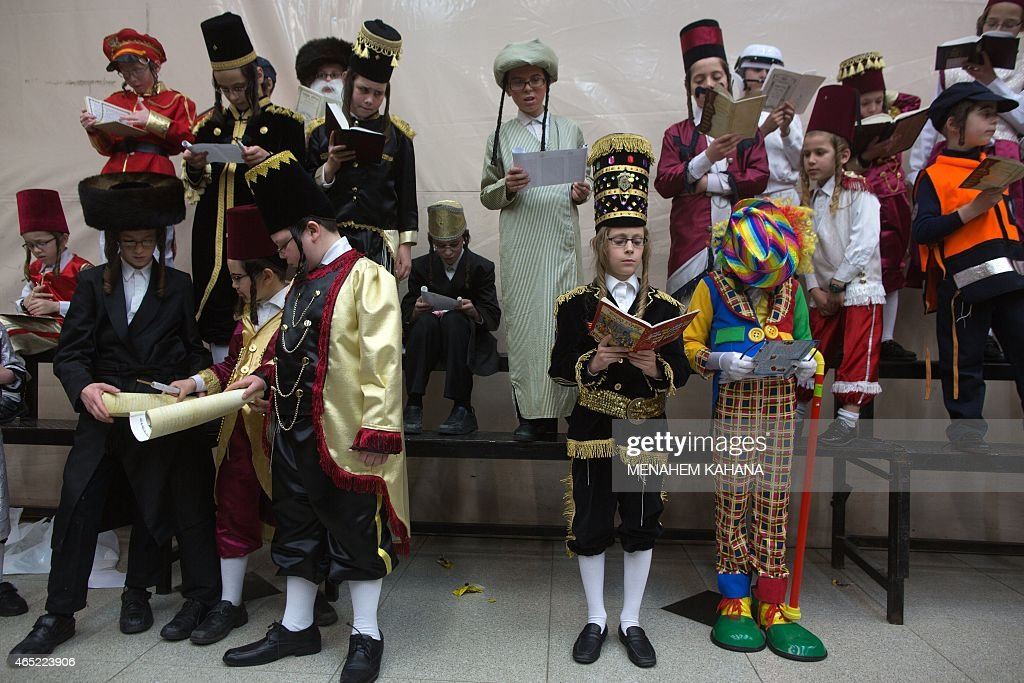 UltraOrthodox Jewish boys wearing costumes read the book of Esther at a synagogue in the Israeli city of Bnei Brak near the costal city of Tel Aviv...