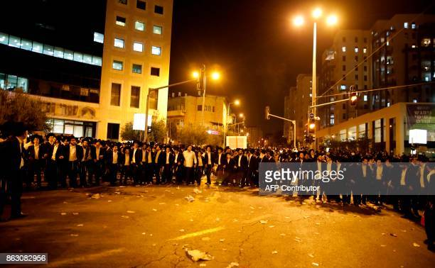 UltraOrthodox Jewish demonstrators block traffic during a protest against Israeli army conscription in the centre of Jerusalem on October 19 2017 /...