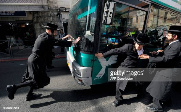 UltraOrthodox Jewish demonstrators impede traffic by blocking a bus as they protest against Israeli army conscription in the centre of Jerusalem on...