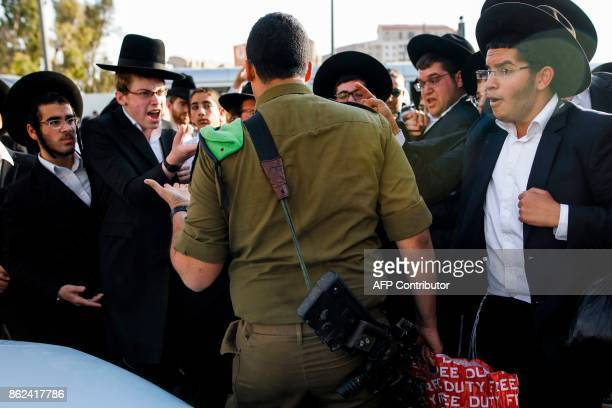 UltraOrthodox Jewish demonstrators shout at an Israeli soldier during a protest against Israeli army conscription in the centre of Jerusalem on...