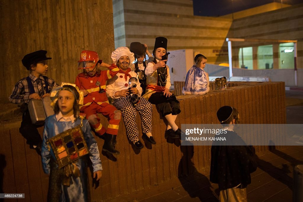 UltraOrthodox Jewish dressedup children play before reading the book of Esther at a synagogue in the Israeli city of Bnei Brak near the costal city...