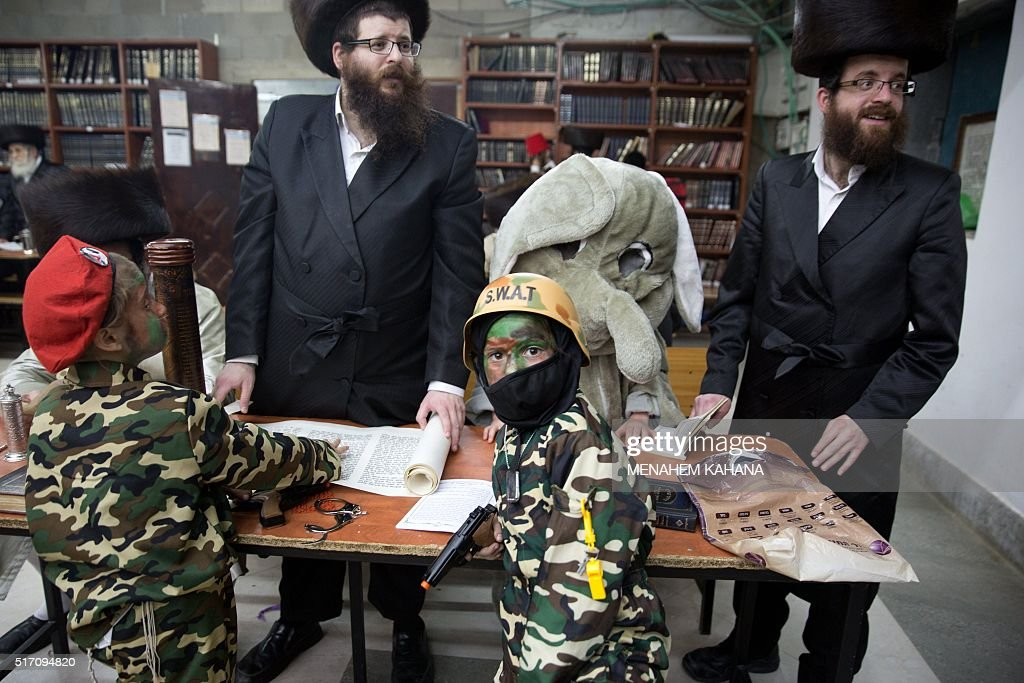 TOPSHOT UltraOrthodox Jewish men and dressed up children read the book of Esther at a synagogue in the Israeli city of Beit Shemesh on March 23 2016...