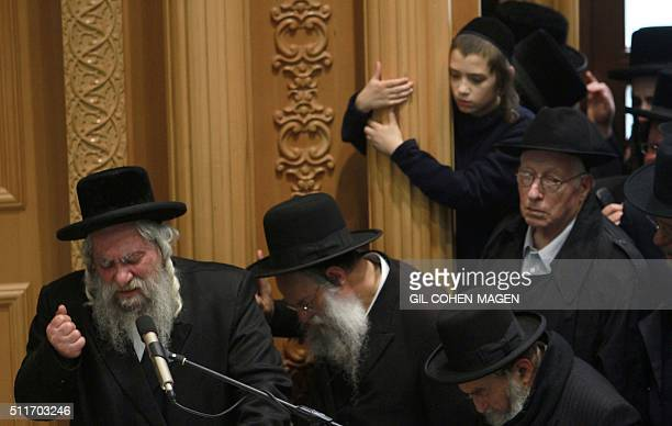 Ultraorthodox Jewish men attend the funeral of rabbi Yochanan Sofer leader of the Erlau Hasidic sect in Jerusalem on February 22 2016 after he passed...