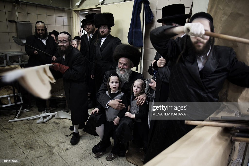 Ultra-Orthodox Jewish men bake the matzoth or unleavened bread for the Pesach holiday (Passover) in Jerusalem on March 25, 2013. Religious Jews throughout the world eat matzoth during the eight-day Pesach holiday (Passover), which begins on March 25 at sunset and commemorates the Israelites' exodus from slavery in Egypt some 3,500 years ago and their plight by refraining from eating leavened food products.