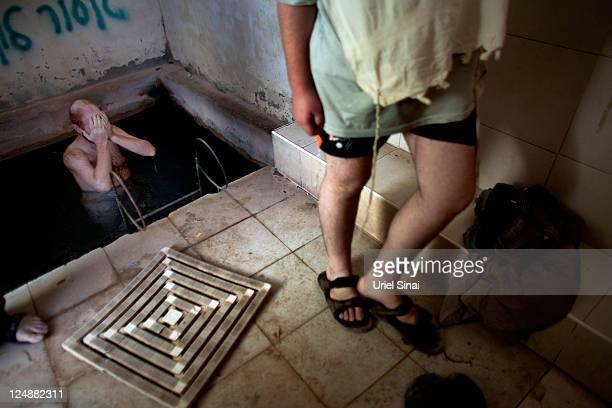 UltraOrthodox Jewish men bath in a ritual bath on August 13 2011 near the Jewish Settlement of Har Bracha West Bank Palestinian President Mahmoud...