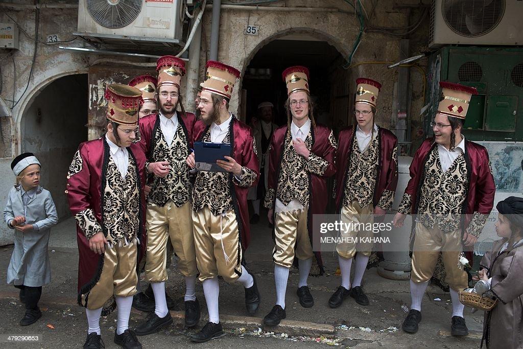 UltraOrthodox Jewish men dressed in costumes celebrate the Purim holiday in the ultraorthodox Mea Shearim neighborhood in Jerusalem on March 17 2014...