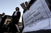 UltraOrthodox Jewish men hold placards calling on Pope Francis to stay in Rome during a protest against his upcoming visit on May 12 2014 in the Old...