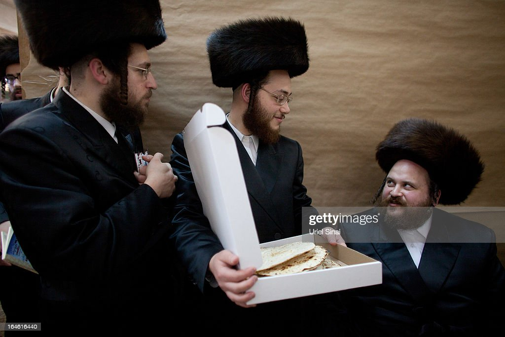 Ultra-Orthodox Jewish men inspect their Matzoth, or unleavened bread, in a final preparation before the start at sundown of the Jewish Pesach (Passover) holiday on March 25, 2013 in Bnei Brak, Israel. Religious Jews throughout the world eat matzoth during the eight-day Passover, or Pesach, holiday, The Jewish holiday commemorates the Israelis' exodus from Egypt some 3,500 years ago and their ancestors' plight by refraining from eating leavened food. Passover begins March 25 and ends on the evening of April 02. (Photo by Uriel Sinai/Getty Images