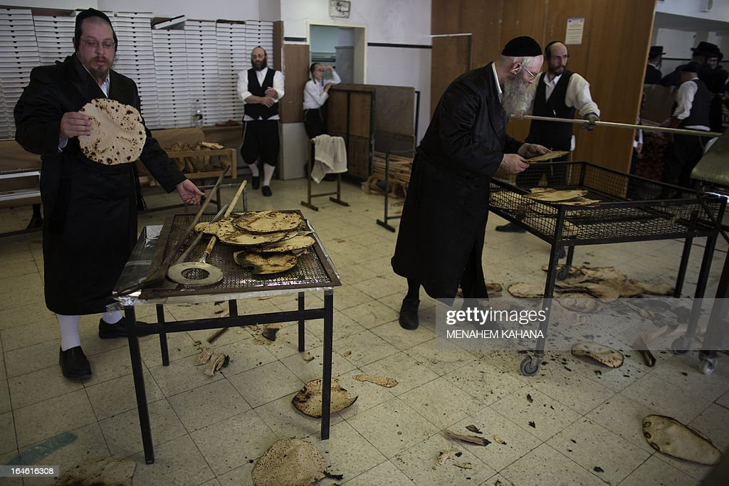 Ultra-Orthodox Jewish men prepare the matzoth or unleavened bread for the Pesach holiday (Passover) in Jerusalem on March 25, 2013. Religious Jews throughout the world eat matzoth during the eight-day Pesach holiday (Passover), which begins on March 25 at sunset and commemorates the Israelites' exodus from slavery in Egypt some 3,500 years ago and their plight by refraining from eating leavened food products.