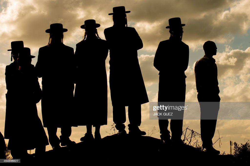 UltraOrthodox Jewish men rally following the arrest of a young man who refused to serve in the Israeli the army as they protest outside the Atlit...