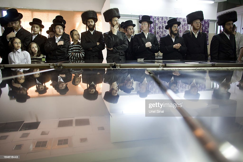 Ultra-Orthodox Jewish men wait for their Rabbi before preparing Matzoth, or unleavened bread, in a final preparation before the start at sundown of the Jewish Pesach (Passover) holiday on March 25, 2013 in Bnei Brak, Israel. Religious Jews throughout the world eat matzoth during the eight-day Passover, or Pesach, holiday, The Jewish holiday commemorates the Israelis' exodus from Egypt some 3,500 years ago and their ancestors' plight by refraining from eating leavened food. Passover begins March 25 and ends on the evening of April 02. (Photo by Uriel Sinai/Getty Images