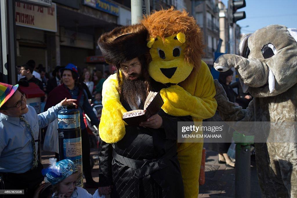 UltraOrthodox Jewish men wearing costumes attend the celebration of the feast of Purim in the Israeli city of Bnei Brak near the coastal city of Tel...