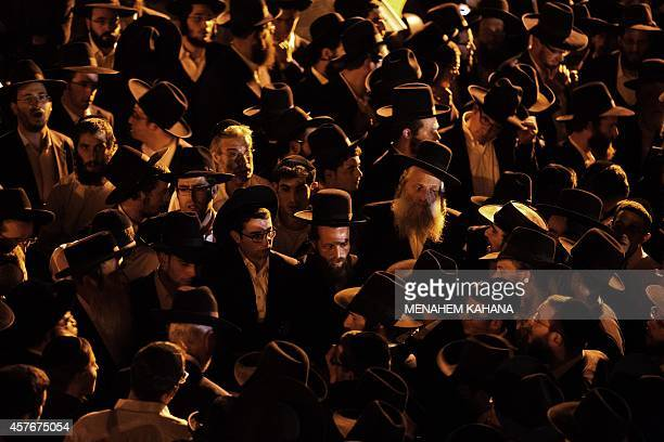 Ultraorthodox Jewish mourners attend the funeral of threemonthold baby Chaya Zissel Braun in Jerusalem on October 23 after she was killed in what...