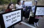 UltraOrthodox Jewish women hold placards reading in Hebrew 'Christian cross never remplace the David Star' during a protest against Pope Francis'...
