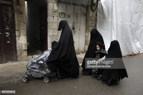 TOPSHOT UltraOrthodox Jewish women known in Israel as 'Neshot Ha Shalim' who cover themselves completely in a burqalike headtotoe black cloth walk...