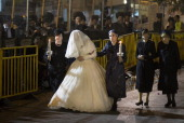 UltraOrthodox Jewish women walk with Hannah Batya Penet the bride of Shalom Rokeach grandson of the Chief Rabbi of Belz during a wedding ceremony on...