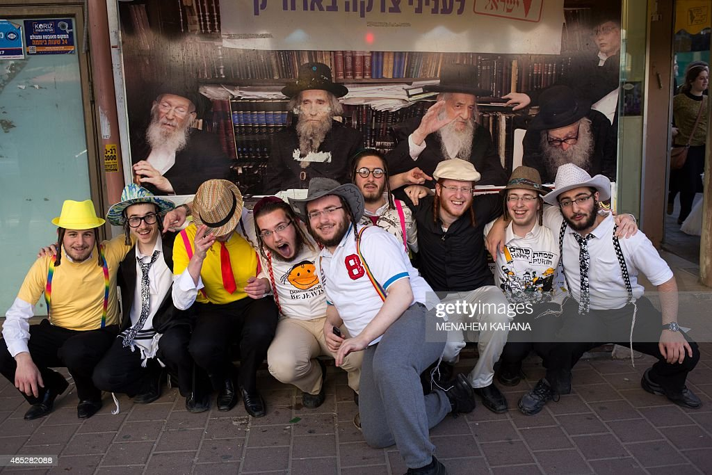 UltraOrthodox Jewish youth pose during celebration of the feast of Purim in the Israeli city of Bnei Brak near the coastal city of Tel Aviv on March...
