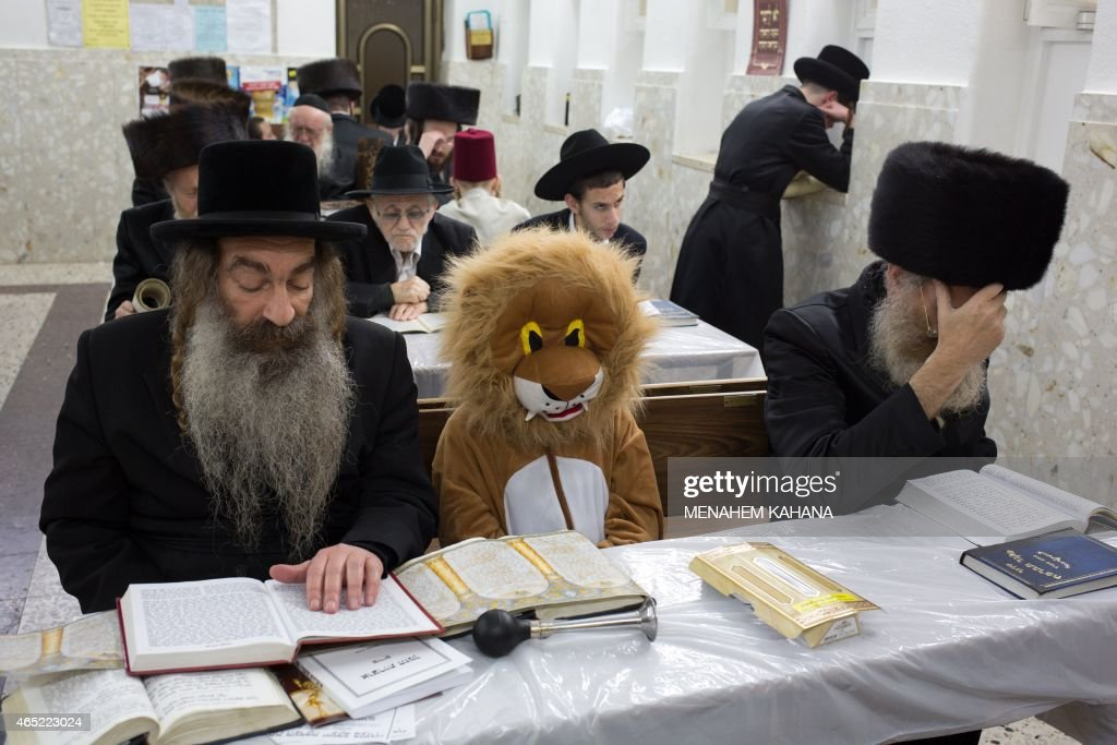 UltraOrthodox Jews and a child wearing a costume read the book of Esther at a synagogue in the Israeli city of Bnei Brak near the costal city of Tel...